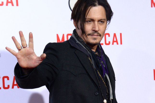Possibly as peacekeeping act between him and Australian government Johnny Depp spent over an hour posing for selfies with fans and signing autographs in full Captain Jack Sparrow costume Tuesday. Photo by Jim Ruymen/UPI