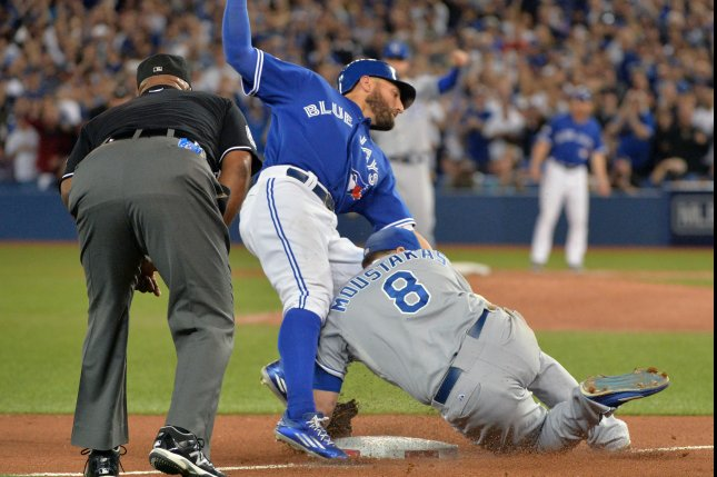 Kansas City Royals third baseman Mike Moustakas (8) tags out Toronto Blue Jays Kevin Pillar at third base during the eighth inning in the ALCS game 5 at the Rogers Centre in Toronto, Canada on October 21, 2015. Pillar's hit scored teammate Troy Tulowitzki on the play. Photo by Kevin Dietsch/UPI