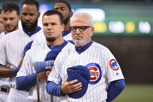 Chicago Cubs manager Joe Maddon (R) stands with his team at Wrigley Field in Chicago on April 11, 2016. The Cubs easily would have earned a first-half A if not for a June-July swoon leading to 20 losses in 34 games. For anybody out there that believes it doesn't happen to every team, you're wrong, said Maddon. Photo by Brian Kersey/UPI
