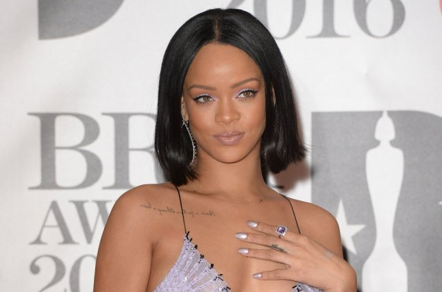 Rihanna attending the Brit Awards at O2 Arena in London on February 24, 2016. After being presented with the Michael Jackson Video Vanguard Award by Drake at the 2016 VMAs, the pair were seen getting close on social media. File Photo by Rune Hellestad/UPI