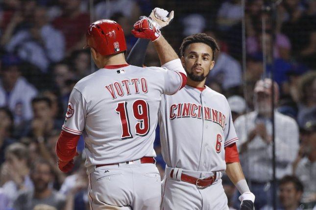 Cincinnati Reds' Joey Votto (L) celebrates with Billy Hamilton (R) after scoring. File photo by Kamil Krzaczynski/UPI
