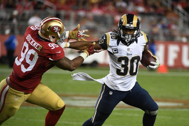 Los Angeles Rams HB Todd Gurley (30) tries to hold off San Francisco 49ers DeForest Buckner (99) at Levi's Stadium in Santa Clara, California on September 12. 2016. File photo by Terry Schmitt/UPI