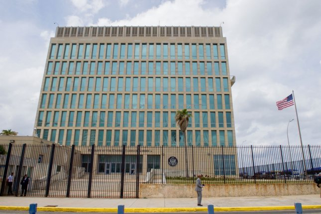 The U.S. flag flaps in the stiff breeze off the Florida Straits at the U.S. Embassy in Havana, Cuba, on March 22, 2016. The State Department on Friday announced that the embassy would only include essential staff going forward. File Photo by U.S. Department of State/UPI