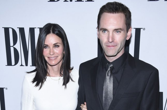 Courteney Cox (L), pictured with Johnny McDaid, discussed the musician and their long-distance relationship in a new interview. File Photo by Phil McCarten/UPI