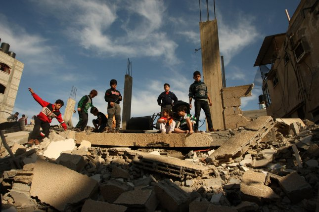 Palestinians examine their home that was destroyed during Israeli airstrikes in Rafah in southern Gaza on Sunday. Palestinian militants fired approximately 430 rockets at Israel and Israel responded with 260 airstrikes. Photo by Ismael Mohamad/UPI