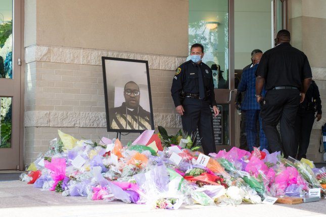 An image of George Floyd is seen at the entrance of the Fountain of Praise Church in Houston during Floyd's funeral on June 9, 2020. File Photo by Trask Smith/UPI