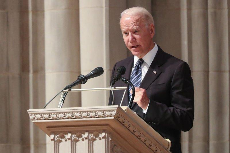 President Joe Biden speaks at the funeral service for Sen. John Warner at Washington National Cathedral in Washington, D.C., on Wednesday. Photo by Oliver Contreras/UPI