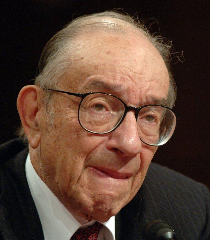 Greenspan defends interest rate policy - UPI com
