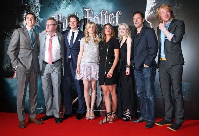 (From L to R) James Phelps, Mark Williams, Oliver Phelps, Clemence Poesy, Natalia Tena, Evanna Lynch, Jason Isaacs and Domhnall Gleeson arrive at the French premiere of the film Harry Potter and the Deathly Hallows: Part 2 in Paris on July 12, 2011. UPI/David Silpa