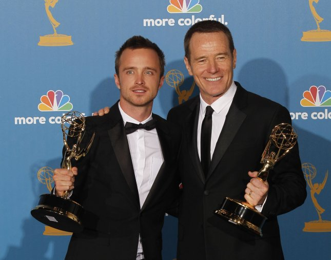 Aaron Paul (L) and Bryan Cranston hold their Emmy Awards for Outstanding Supporting Actor (Paul) and Lead Actor (Cranston) in a Drama Series for their work on Breaking Bad at the 62nd Primetime Emmy Awards at the Nokia Theatre in Los Angeles on August 29, 2010. UPI/Lori Shepler