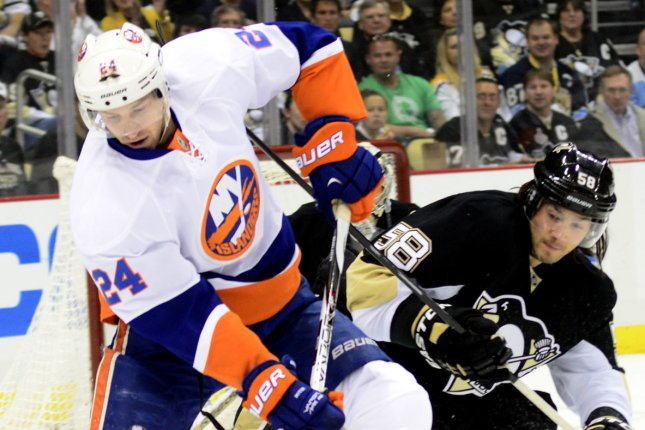 New York Islanders center Brad Boyes (24) reverses direction on Pittsburgh Penguins defenseman Kris Letang (58) during the first period of the Islanders 4-3 win at game two of the Eastern Conference Quarterfinal at the Consol Energy Center in Pittsburgh on May 3, 2013. UPI/Archie Carpenter