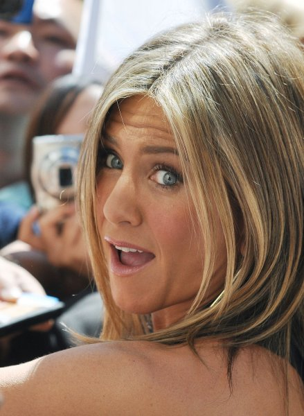 Jennifer Aniston signs autographs for fans as she arrives for the world premiere of 'Cake' at the Elgin Theatre during the Toronto International Film Festival in Toronto, Canada on September 8, 2014. UPI/Christine Chew