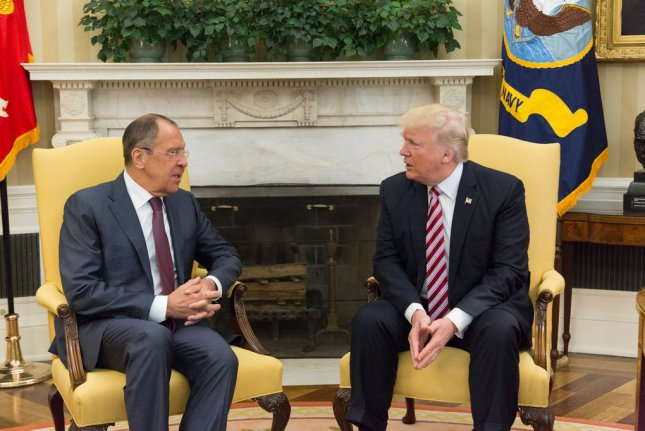 In photos released Monday, President Donald Trump speaks with Russian Foreign Minister Sergey Lavrov in the Oval Office. A majority of Americans said it was inappropriate for Trump to share classified intelligence with the Russians during the meeting. Official White House Photo by Shealah Craighead/UPI