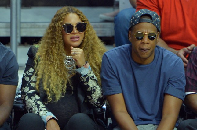 Beyoncé (L) and Jay Z attend an NBA playoffs game between the Los Angeles Clippers and Utah Jazz on April 30. The singer's dad, Mathew Knowles, announced Sunday that Beyoncé recently gave birth. File Photo by Jim Ruymen/UPI
