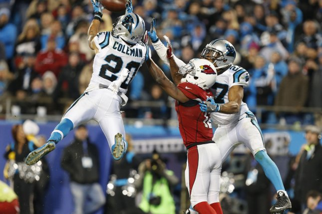Carolina Panthers safety Kurt Coleman, left, intercepts an Arizona Cardinals pass in the second half of the NFC championship football game in 2016 at Bank of America Stadium in Charlotte, N.C. File photo by Brian Westerholt/UPI