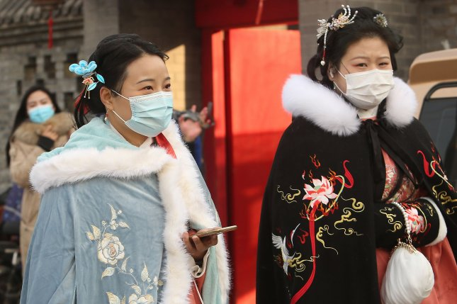 Young women are the pillar of China's consumerist economy -- and they have a significant impact on policy making. Photo by Stephen Shaver/UPI