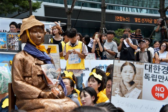"Activists in South Korea have raised awareness about ""comfort women"" forced to serve in Japan's wartime brothels and have demanded a formal apology from the Japanese government. File Photo by Keizo Mori/UPI"