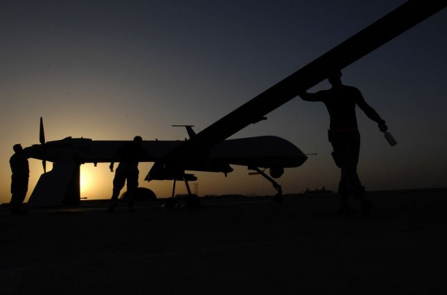 Airman 1st Class Justin Cole, Tech. Sgt. Marcus Cottengim and Chief Master Sgt. Roy Cupper conduct a pre-flight inspection on an MQ-1 Predator unmanned aerial vehicle prior to a night mission from Ali Air Base, Iraq on November 5, 2007. The Predators operate on 24-hour operations in support of Operation Iraqi Freedom. UPI/Jonathan Snyder/U.S. Air Force