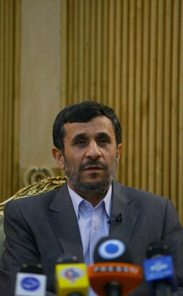 Iranian President Mahmoud Ahmadinejad speaks to the press upon his return to Tehran after visiting five African and South American countries, including Brazil, at Mehr-Abad International Airport in Tehran, Iran, November 27,2009. UPI/Maryam Rahmanian..