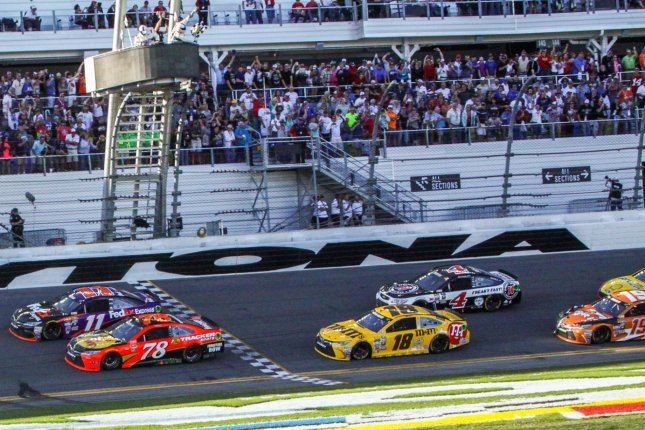 Denny Hamlin (11) wins the Daytona 500 by inches over Martin Truex Jr (78), the closest Daytona 500 ever. Kyle Busch (18) was third at Daytona International Speedway on February 21, 2016 in Daytona, Florida. Photo by Mike Gentry/UPI