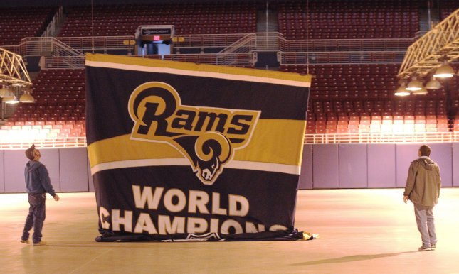 Decoraters wait for the St. Louis Rams Super Bowl banner to lower from the rafters of the Edward Jones Dome in St. Louis on Jan. 14 for their move back to Los Angeles. They own the first round draft pick and will go after a quarterback, likely Carson Wentz. Photo by Bill Greenblatt/UPI