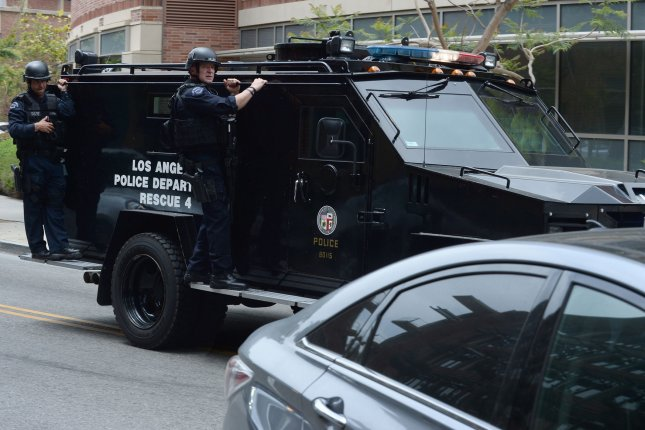 The Los Angeles Police Department SWAT unit responds with federal agents of the FBI and ATF to the campus of the University of California, Los Angeles, on Wednesday, June 1. Photo by Jim Ruymen/UPI