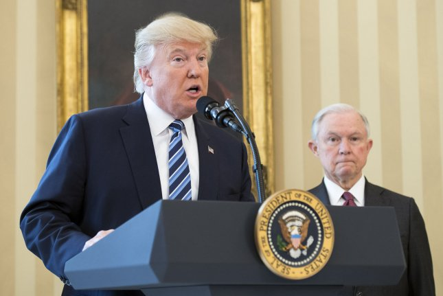 The administration of President Donald Trump, seen here speaking alongside recently sworn-in Attorney General Jeff Sessions on Thursday, has requested to withdraw a motion filed by former President Barack Obama that sought to allow transgender students in public schools to use the restroom with which they identify. Photo by Kevin Dietsch/UPI