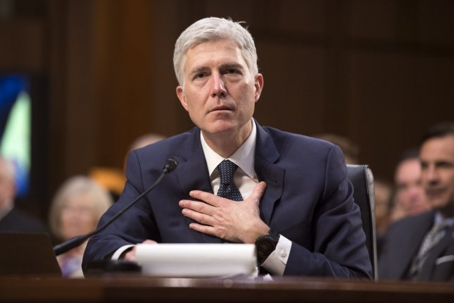 Supreme Court Justice nominee Neil Gorsuch testifies during the third day of his confirmation hearing before the Senate Judiciary Committee on Capitol Hill on March 22. On Friday, the Senate voted to approve his nomination to the high court. Photo by Kevin Dietsch/UPI