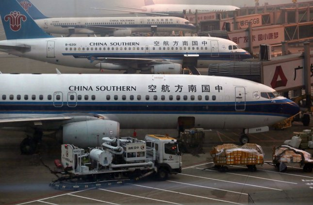 An elderly passenger delayed a China Southern flight for nearly five hours after tossing several coins near the engine for good luck. Photo by Stephen Shaver/UPI