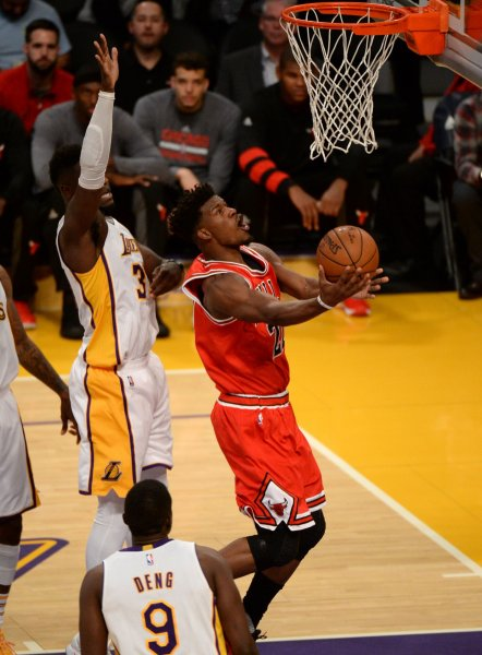 Former Chicago Bulls forward Jimmy Butler (21) scores by Los Angeles Lakers forward Julius Randle (30) at Staples Center in Los Angeles, November 20, 2016. A Chicago-area man has been inundated with phone calls meant for Butler after the NBA star gave out his personal phone number to critics during a press conference with his new team, the Minnesota Timberwolves. File Photo by Jon SooHoo/UPI