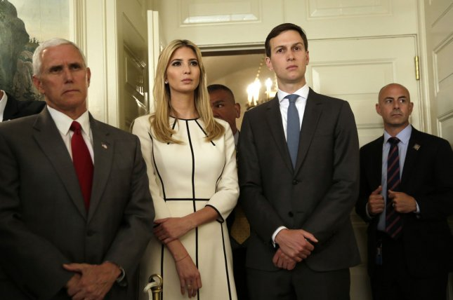 Presidential adviser Jared Kushner, standing next to wife Ivanka Trump, has been ordered by the House Oversight Committee to turn over details of private emails he used to conduct White House business. File Photo by Yuri Gripas/UPI