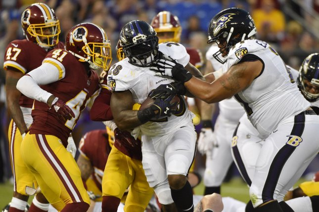 Baltimore Ravens running back Terrance West (28) scores a two yard rushing touchdown against the Washington Redskins during the first half of their NFL preseason game on August 10 at M&T Bank Stadium in Baltimore, Md. Photo by David Tulis/UPI
