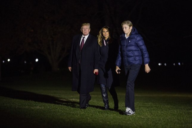 President Donald Trump crosses the South Lawn with first lady Melania Trump and their son, Barron Trump, after returning to the White House from a Thanksgiving weekend vacation at his Mar-a-Lago resort in Palm Beach, Fla. on Sunday. Photo by Zach Gibson/UPI