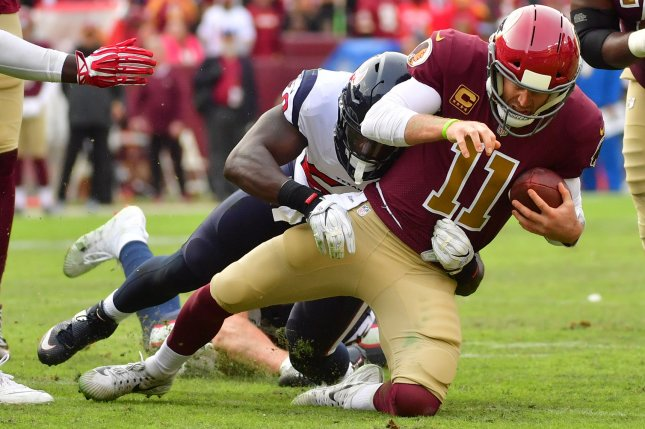 Washington Redskins quarterback Alex Smith is not expected to play this season after breaking his leg during a loss to the Houston Texans in November. File Photo by Kevin Dietsch/UPI
