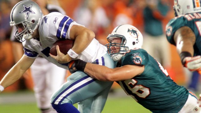 In this file photo, Dallas Cowboys quarterback Stephen McGhee (7) is sacked by Miami Dolphins linebacker Jason Trusnik (46) during the game between the Miami Dolphins and the Dallas Cowboys September 1, 2011, at Sun Life Stadium in Miami, Florida. The Miami Dolphins beat the Dallas Cowboys 17-3. . . UPI Photo/Susan Knowles