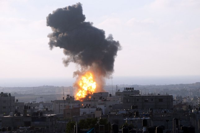 A ball of fire is seen following an Israeli air strike in Rafah, in the southern Gaza Strip, on July 8, 2014. Hamas said that all Israelis would be targeted after a deadly strike on a house in the southern city of Khan Yunis killed seven people, among them two teenagers. Medics said another 25 people were wounded in the strike. Israel launched an offensive against Islamist Hamas in the Gaza Strip, bombed dozens of targets. UPI/Ismael Mohamad