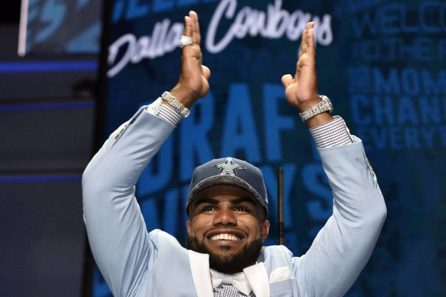 Ohio State running back Ezekiel Elliott walks onto the stage after being selected by the Dallas Cowboys with the fourth overall pick in the 2016 NFL Draft on April 28, 2016 in Chicago. Photo by Brian Kersey/UPI