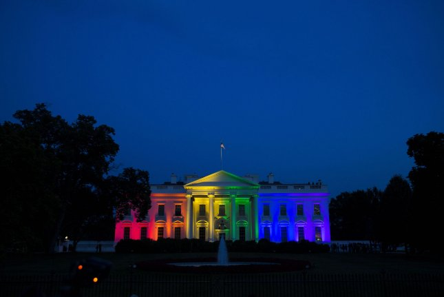 The White House is illuminated with rainbow light in June 2015 following a 5-4 vote by the U.S. Supreme Court that effectively legalized same-sex marriage in the United States. The Department of State on Monday formally apologized for the mass firing of hundreds of gay and transgender employees in the mid-20th century on the basis that their sexual orientation constituted a national security risk. Secretary of State John Kerry issued the apology. File Photo by Drew Angerer/UPI