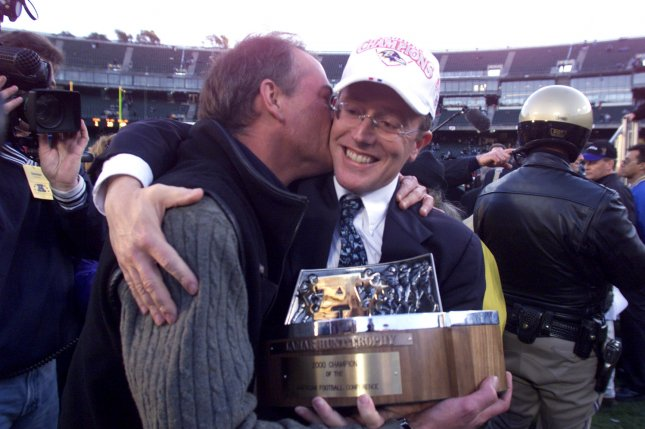 Baltimore Ravens President and COO David Modell gets a hug and kiss from a tearful John Moag after AFC Championship game in Oakland, California, on January 14, 2001. The Ravens defeated the Raiders 16-3 to move on to Super Bowl XXXV. File Photo by Terry Schmitt/UPI