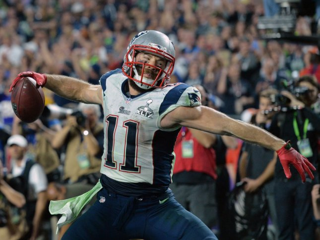 Julian Edelman celebrates after catching a touchdown pass in a game against the Seattle Seahawks. Photo by Kevin Dietsch/UPI