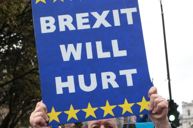 An anti-Brexit demonstrator holds a sign outside the Houses of Parliament in London. File Photo by Hugo Philpott/UPI