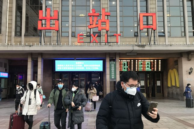 Chinese people return to the capital after a lengthened Lunar New Year holiday due to the threat of spreading the deadly coronavirus in Beijing on Monday, February 10, 2020. The virus killed 97 people in China on Sunday, bringing the death toll to 910 with more than 40,000 infections across 27 countries. Photo by Stephen Shaver/UPI