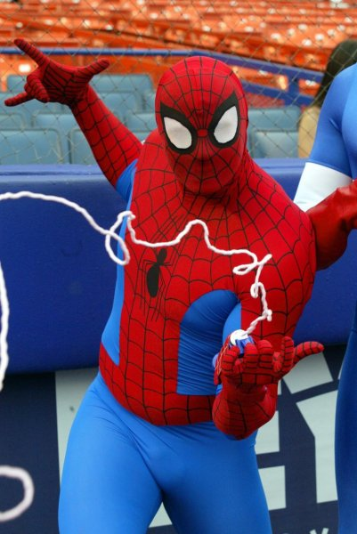 NYP2002050753 - NEW YORK, May 7, (UPI) --Spiderman poses for pictures at Shea Stadium prior to the New York Mets v. San Francisco Giants game on May 7, 2002, at Shea Stadium in New York. rlw/lc/laura Cavanaugh UPI