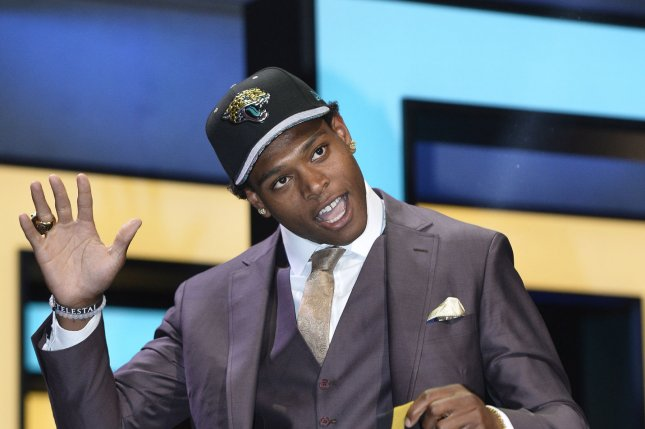Jalen Ramsey waves after being selected by the Jacksonville Jaguars with the fifth overall pick in the 2016 NFL Draft on April 28, 2016 in Chicago. Photo by Brian Kersey/UPI
