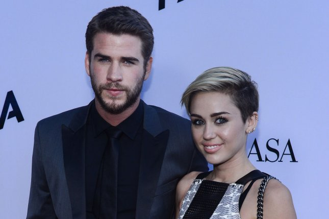 Liam Hemsworth (L) and Miley Cyrus attend the Los Angeles premiere of Paranoia on August 8, 2013. The actor shared a new picture with Cyrus on Sunday. File Photo by Jim Ruymen/UPI