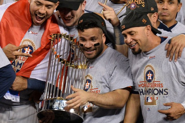 Houston Astros Jose Altuve holds Commissioners Trophy surrounded by teammates after defeating the Los Angeles Dodgers in the 2017 MLB World Series game seven at Dodger Stadium in Los Angeles on November 1, 2017. The Astros beat the Dodgers 5-1 to claim their first ever World Series championship. Photo by Jim Ruymen/UPI