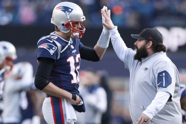 New England Patriots quarterback Tom Brady (12) high fives defensive coordinator Matt Patricia (R) after arriving on the field without a glove on his injured right hand before playing the Jacksonville Jaguars in the AFC Championship Game on January 21, 2018 at Gillette Stadium in Foxborough, Massachusetts. Photo by Matthew Healey/UPI