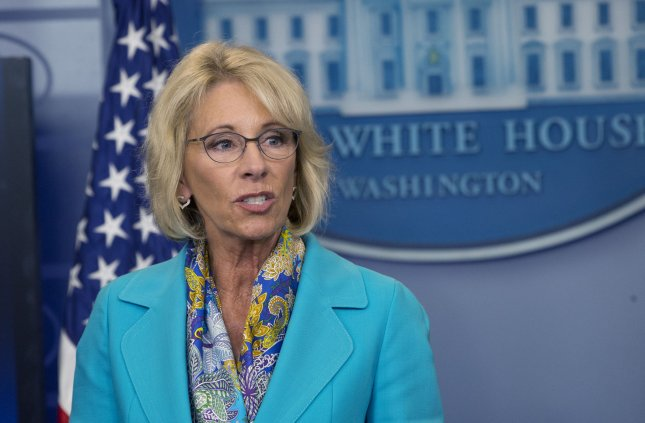 Education Secretary Betsy DeVos and the Department of Education were ordered to stop collecting loans from students defrauded by Corinthian Colleges. File Photo by Pat Benic/UPI