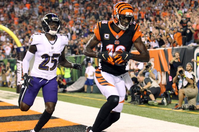 Cincinnati Bengals wide receiver A.J. Green (18) makes a touchdown catch under pressure from the Baltimore Ravens defender Tavon Young (25) during the first half of play on Thursday at Paul Brown Stadium in Cincinnati. Photo by John Sommers II/UPI