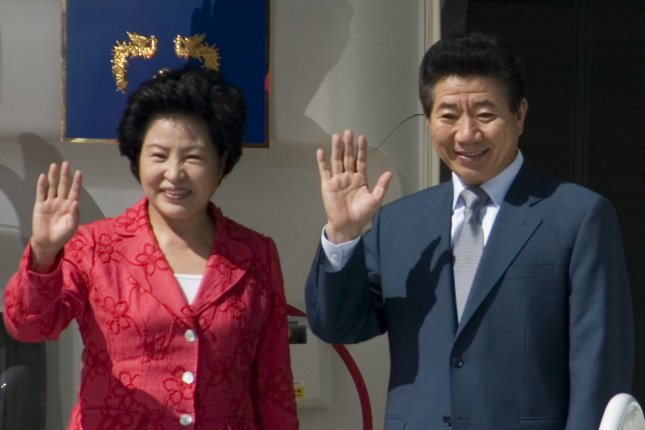 Roh Moo-hyun, president of South Korea, (R) and his wife, Kwon Yang, wave to Korean-American community leaders before departing from Boeing Field in Seattle on July 1, 2007. Linked to a corruption investigation, Roh killed himself on this day in 2009. File Photo by Jim Bryant/UPI